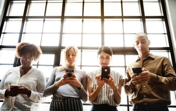 group checking their mobile